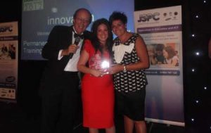 Katy Jobbins Receiving Winner 2012 Innovation in Business Award From TV Presenter Fred Dinage