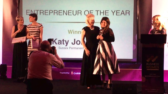 Katy Jobbins recieving Sussex Entreprener of the Year Award 2016