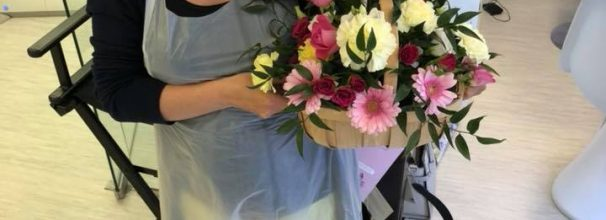 Katy Jobbins receiving flowers from permanent makeup student