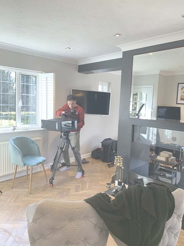 Camera Man setting up at the House Rich House Poor House